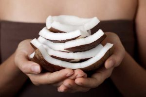 Resized_Woman_Holding_Coconut_Slices_81669139